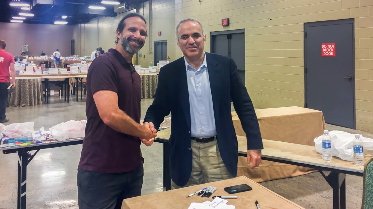 Steven (left) shaking hands with the legendary Garry Kasparov (right), reigning World Chess Champion from 1985-2000