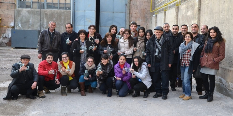 Group photo in front of the recycling factory with gifted recycled vessels