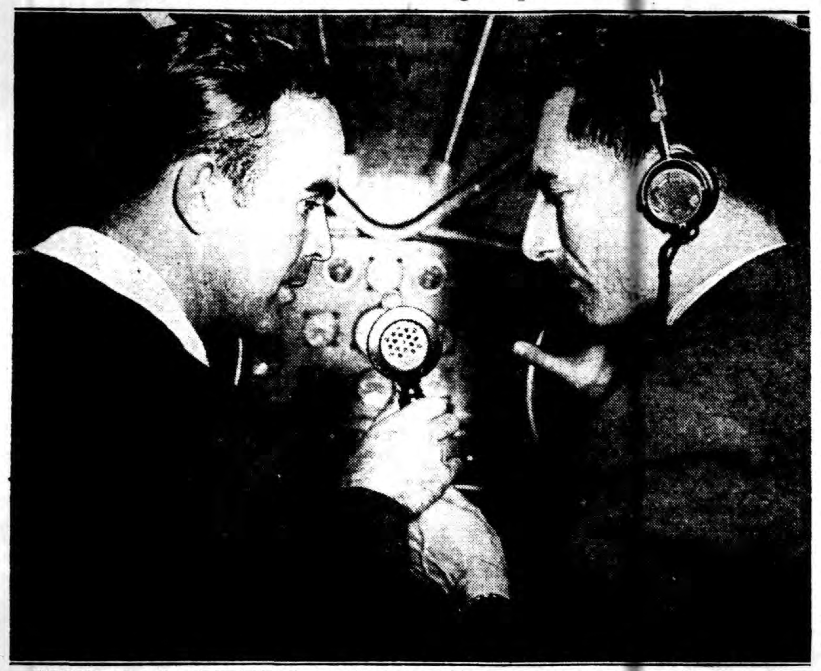 William Howell, seated at left, radios from his plane that the Hindenburg had just been spotted off the coast of the United States on its maiden flight from Europe. Photo from the August 11th, 1936 edition of the Long Island Daily Press.