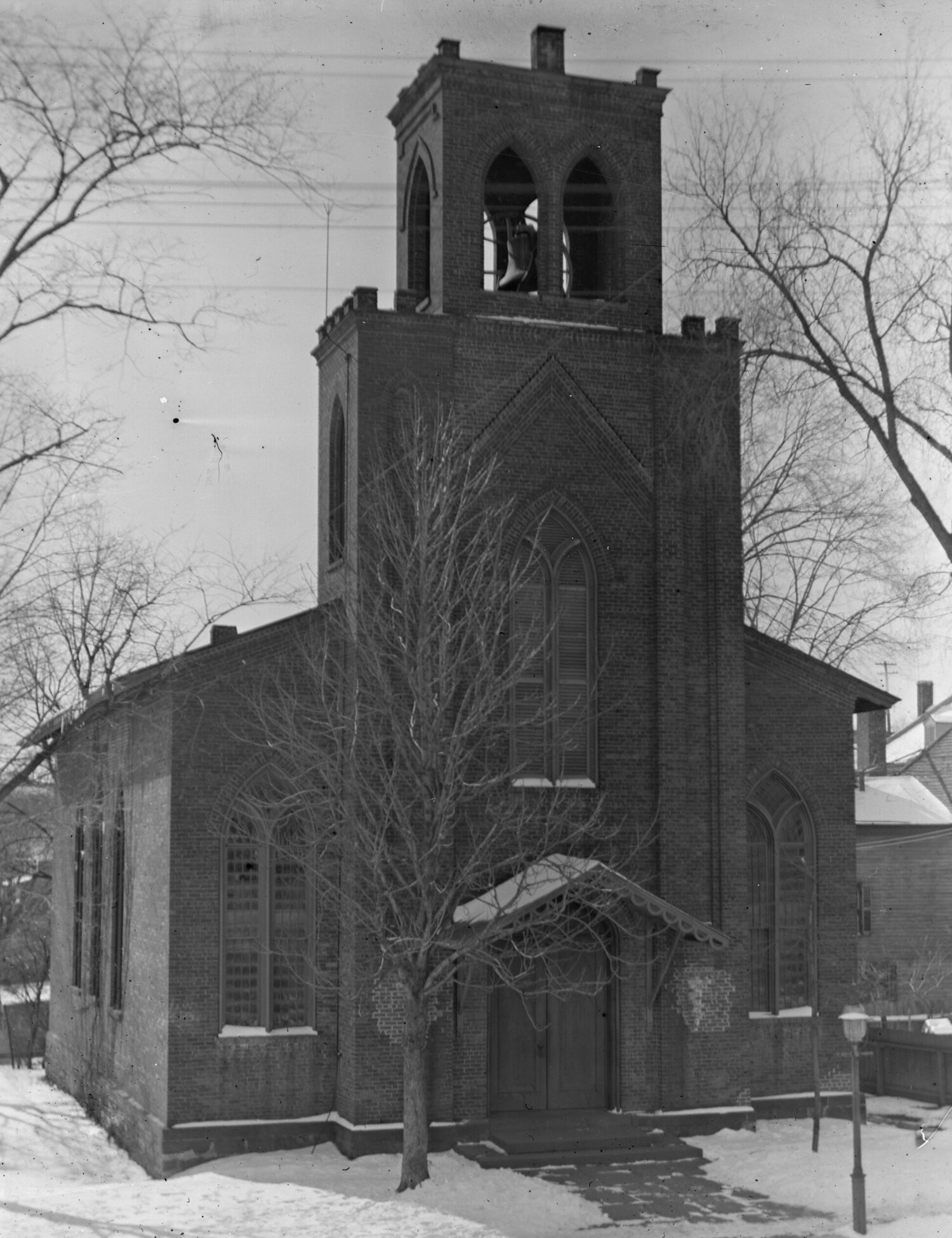The second St. Luke's Episcopal Church immediately after it was vacated in 1896. This was previously thought to be the earliest view of the church in existence, and shows the bell tower which was added much later, rather than incorporated into Thomas Cole's original design. Photo from the S. E. Davis Negatives Collection, Vedder Research Library.