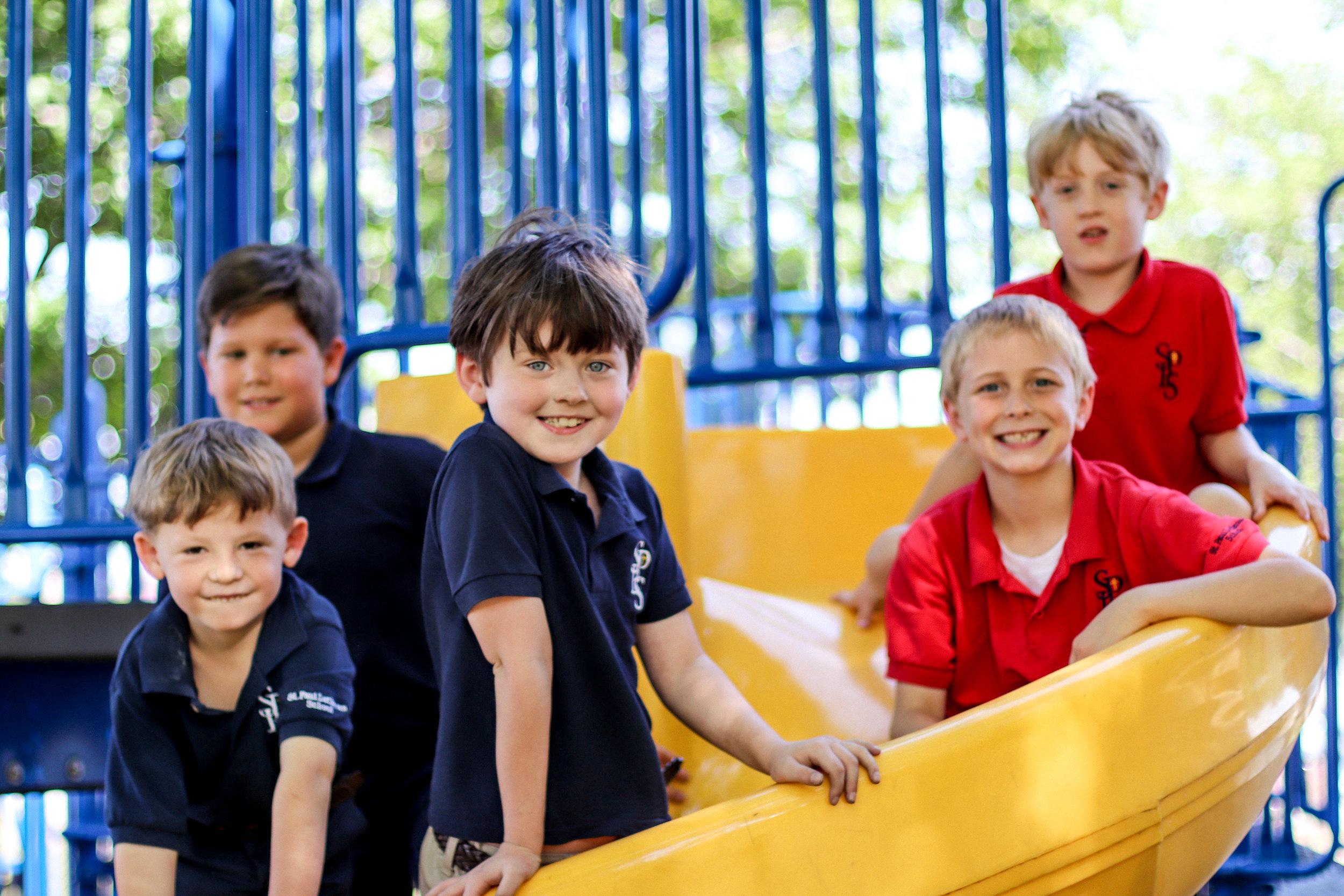 4 boys on the slide.jpg