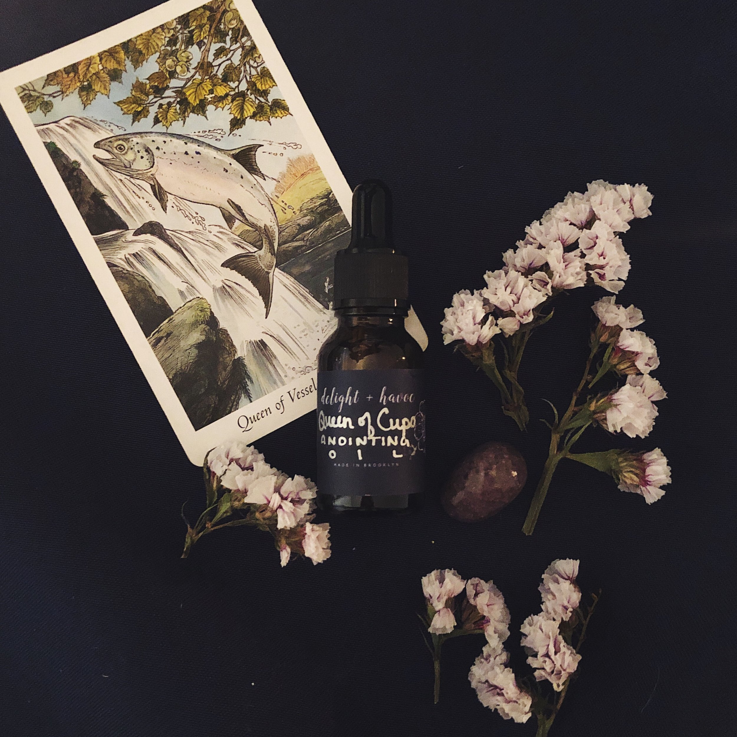 QUEEN OF CUPS - Crafted over one moon cycle during Libra season with the Queen of Cups tarot card and charged and blessed on the November 2018 Dark Moon in Scorpio, our QUEEN OF CUPS Anointing Oil is imbued with herbs and flowers that help protect and fortify your powerful and sensitive heart. Several of our customers have said it's like a warm hug in a bottle.Perfect for:- Heart healing & fortification- Courage- Empathic protection and support- Self love- Can also be used to aid in strengthening your resolve in uncrossing work (though not necessarily for the work itself)