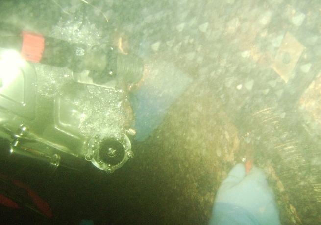 Diver attaching bracket to the bridge pier