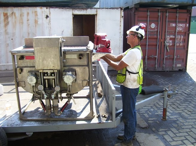 Substructure employee doing maintenance work on patented epoxy pump
