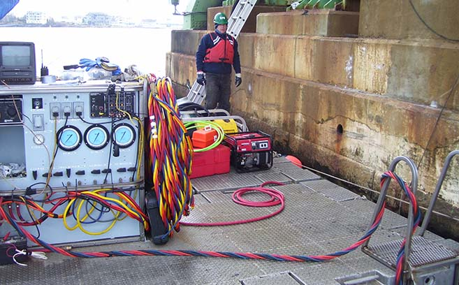 Surface supplied diving set up for bridge repair.