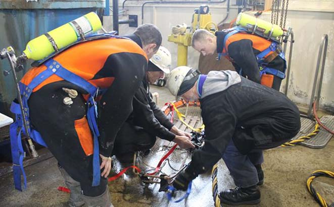 Divers during specialized confined space rescue training.