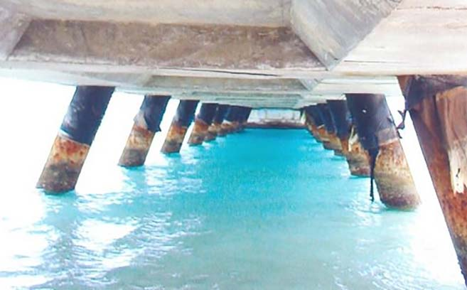 An example of atmospheric corrosion at a pier in the Cayman Islands.