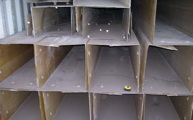 Fiberglass jackets await prep work before installation at shipping port.