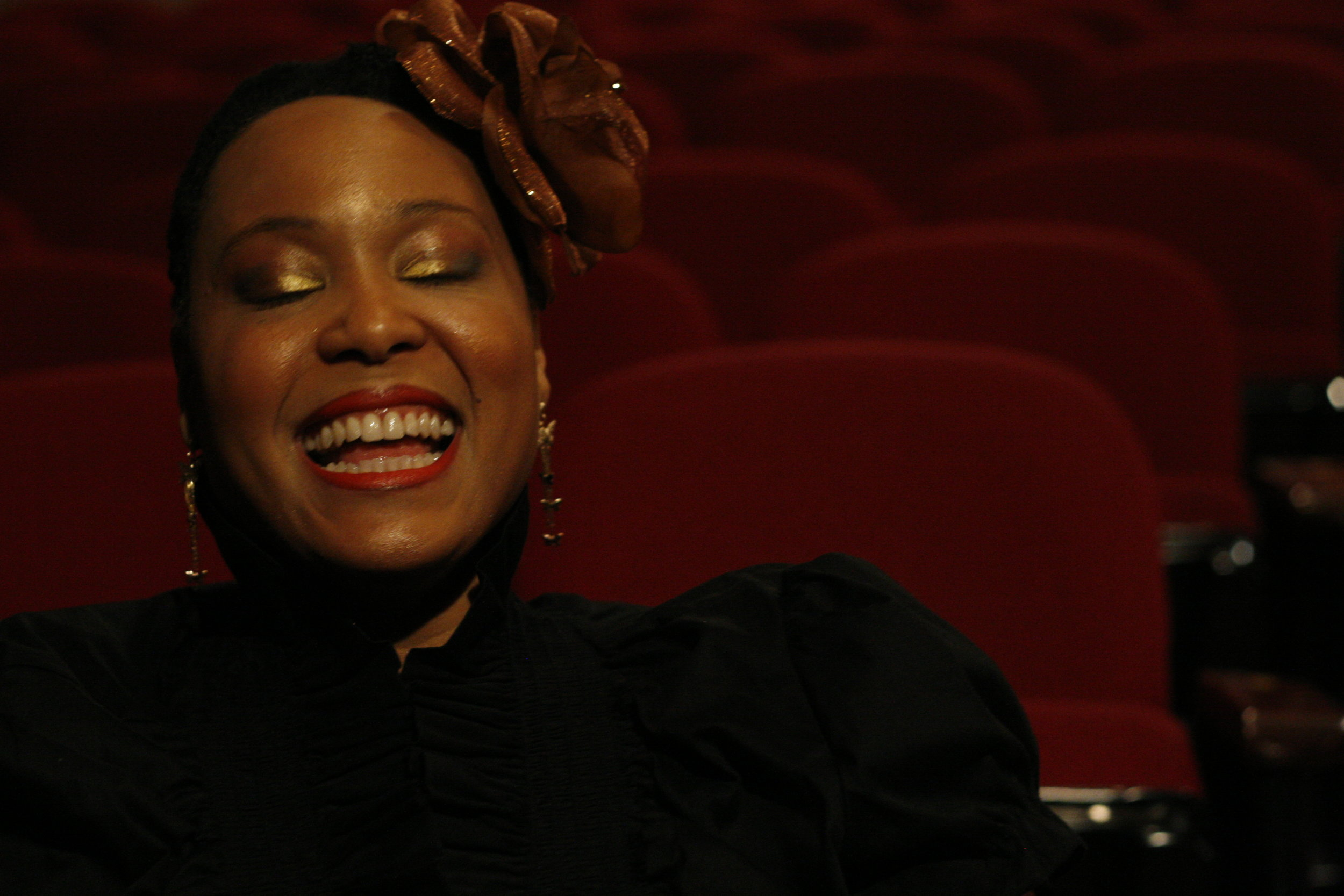 writer performer    activist healer   scholar  rootwoman    -