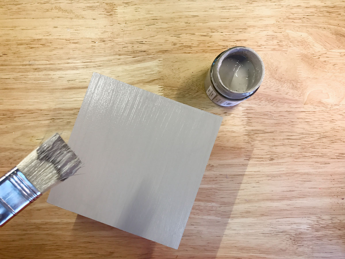 Painting the base of the lantern with Tommy DIY Paint