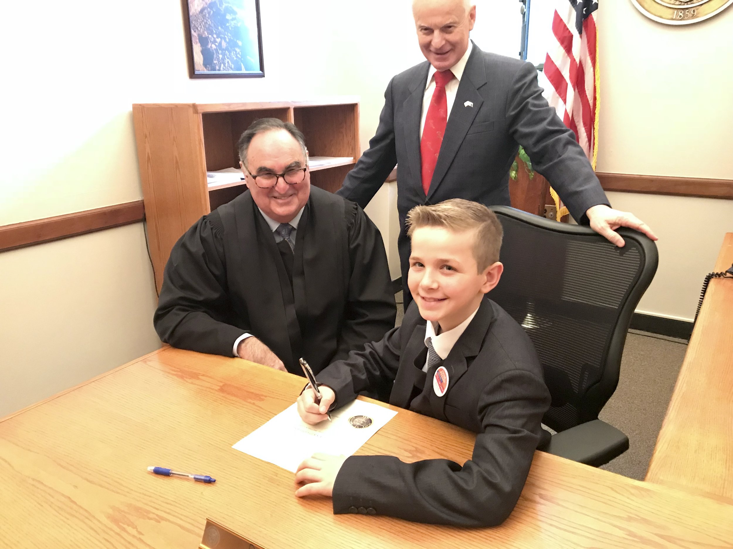 Dom Peters signing his official Oath of Office.