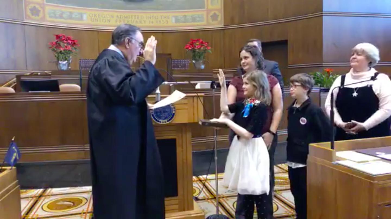 PHOTO:  Erikka Baldwin sworn in by Former Chief Justice Paul DeMuniz as Oregon's Kid Governor.