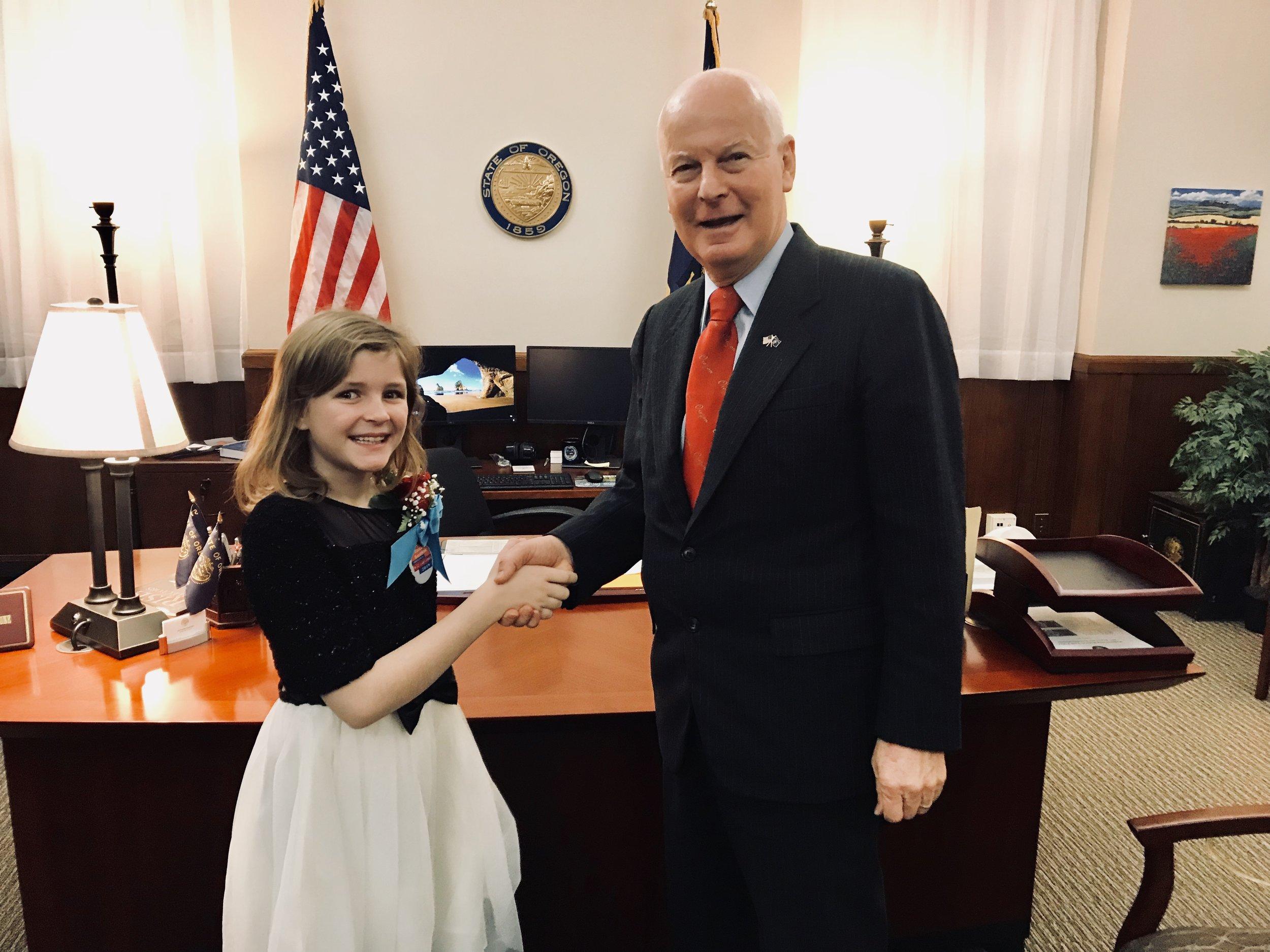PHOTO:  Erikka Baldwin congratulated by Secretary of State Dennis Richardson.