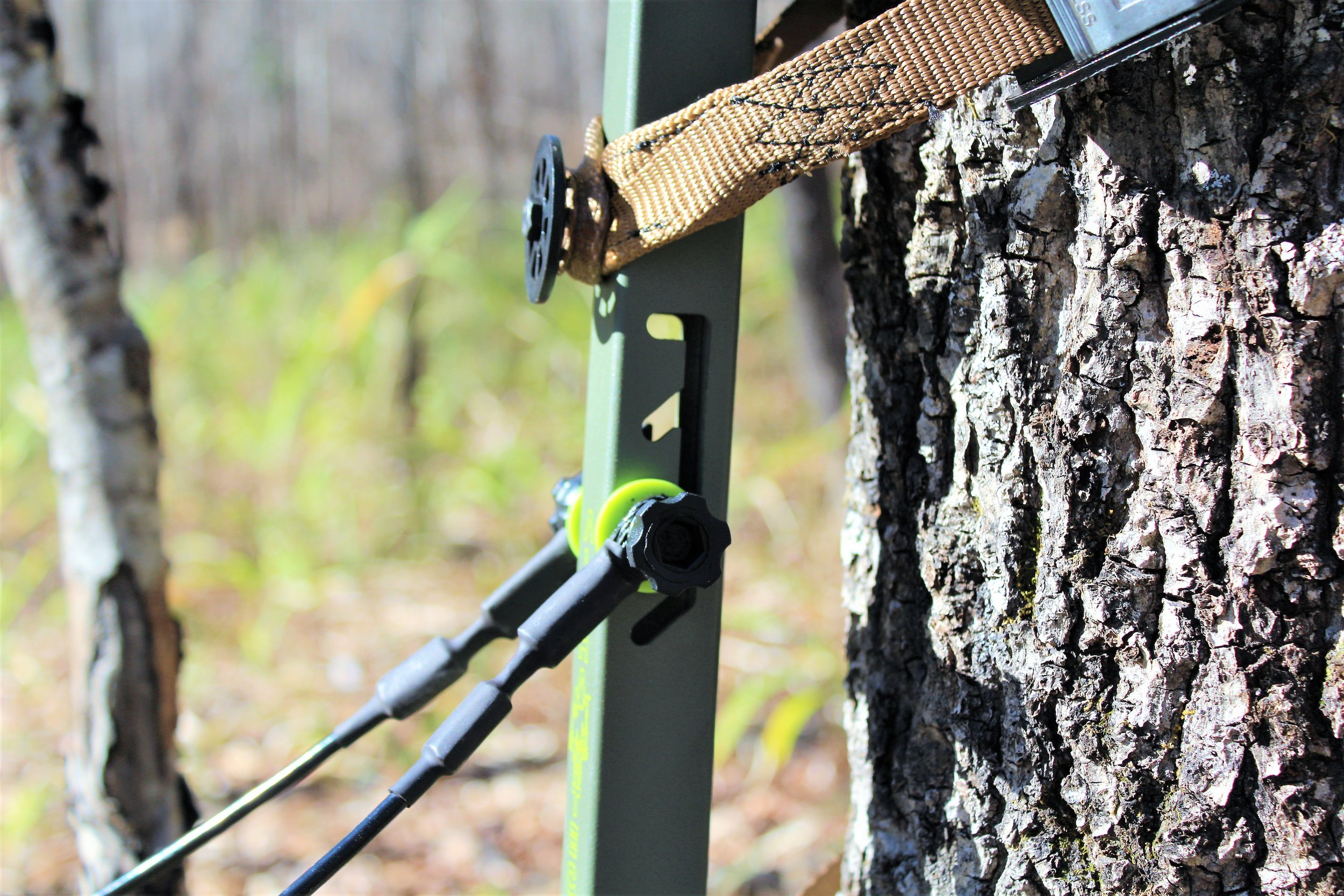 A look at the platform leveling system on the stand. This feature saves time while hanging the stand, especially when hanging in the dark. Also take note of the strap that goes around the tree. Lone Wolfs versa button system is not only easy to use, but its also deadly silent.