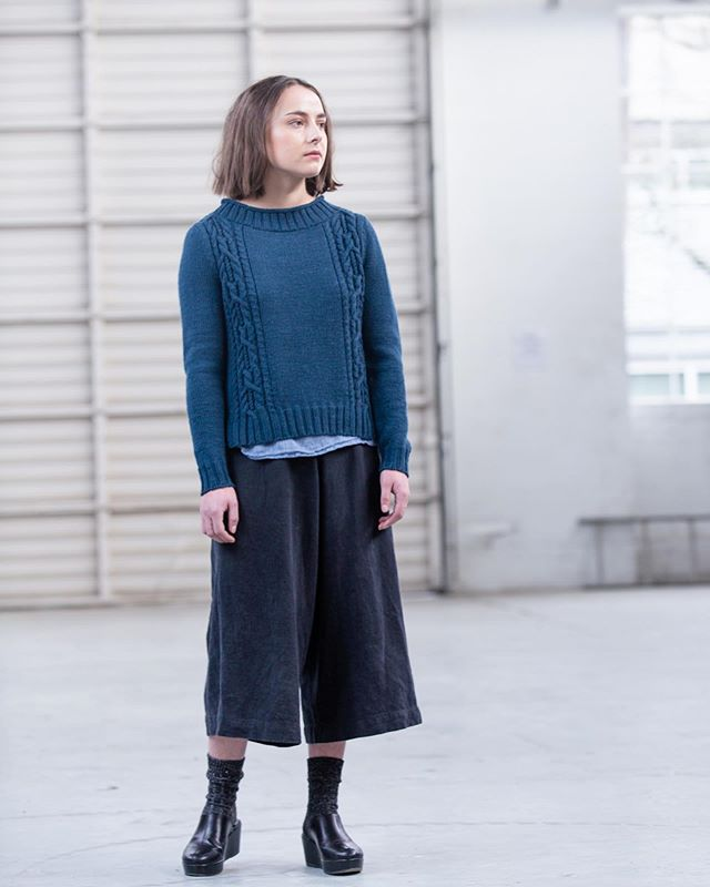 It's Wednesday and that means it's officially Wool People release day! I am so proud and so honored to be a contributor to this beautiful collection of designs curated by @brooklyntweed . Say hello to Seamark. I loved designing and knitting this sweater, and I hope you love it just as well. You can find the link to the pattern in my profile. 💙 - A rolled edge at the collar and a split hem give the Seamark pullover an air of rugged nonchalance. Knit in worsted-spun DK weight Arbor yarn, the meaty ribbing at the hem and collar flows into cables that twist and knot up to the shoulders. These elements combine in a sturdy pullover reminiscent of the fisherman sweaters of yore. - photo by @jared_flood courtesy of @brooklyntweed - - - - - #brooklyntweed #seamarkpullover #woolpeople13 #knittersofinstagram #knitting #knit #brookylntweedarbor #knitstagram #instaknit #sweater #cableknitting #strikk #tricot #knitspiration #maker #knitter