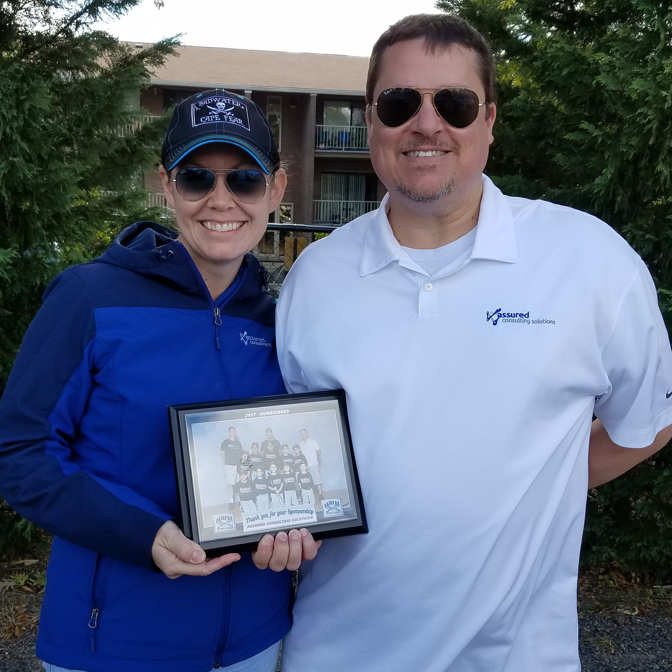 ACS Managing Partner (Erin Willett, Left) and ACS Chief Technology Officer (Steve Willett, Right) accept a plaque from the Fairfax Little League thanking Assured Consulting Solutions for their Fall 2017 team sponsorship.