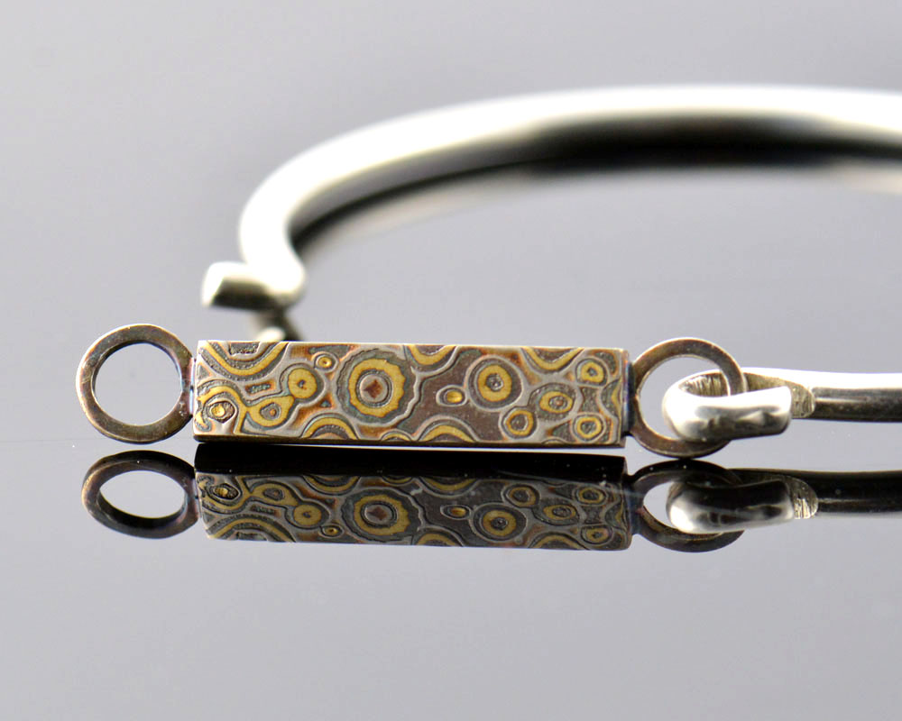 Rain - 18k yellow gold and palladium with a wild liver of sulfur patina