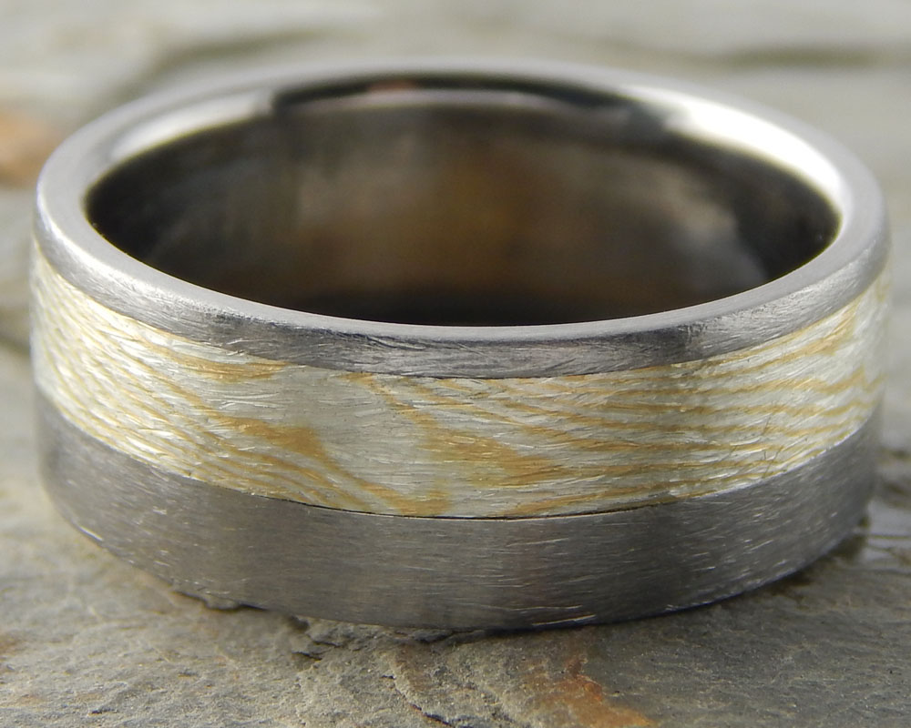 Woodgrain - 18k yellow gold offset inlay into titanium