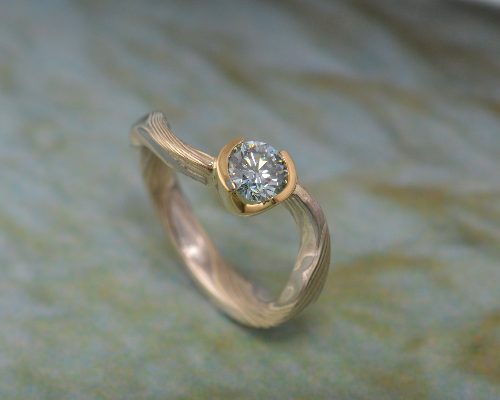 Design an engagement ring with a twist and a rare center stone. An aqua diamond in this case.