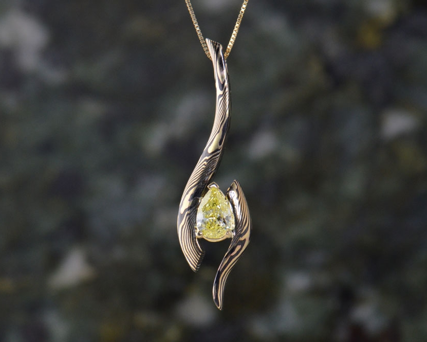 Pendants like this yellow pear diamond and other classic accessories are yours to design.