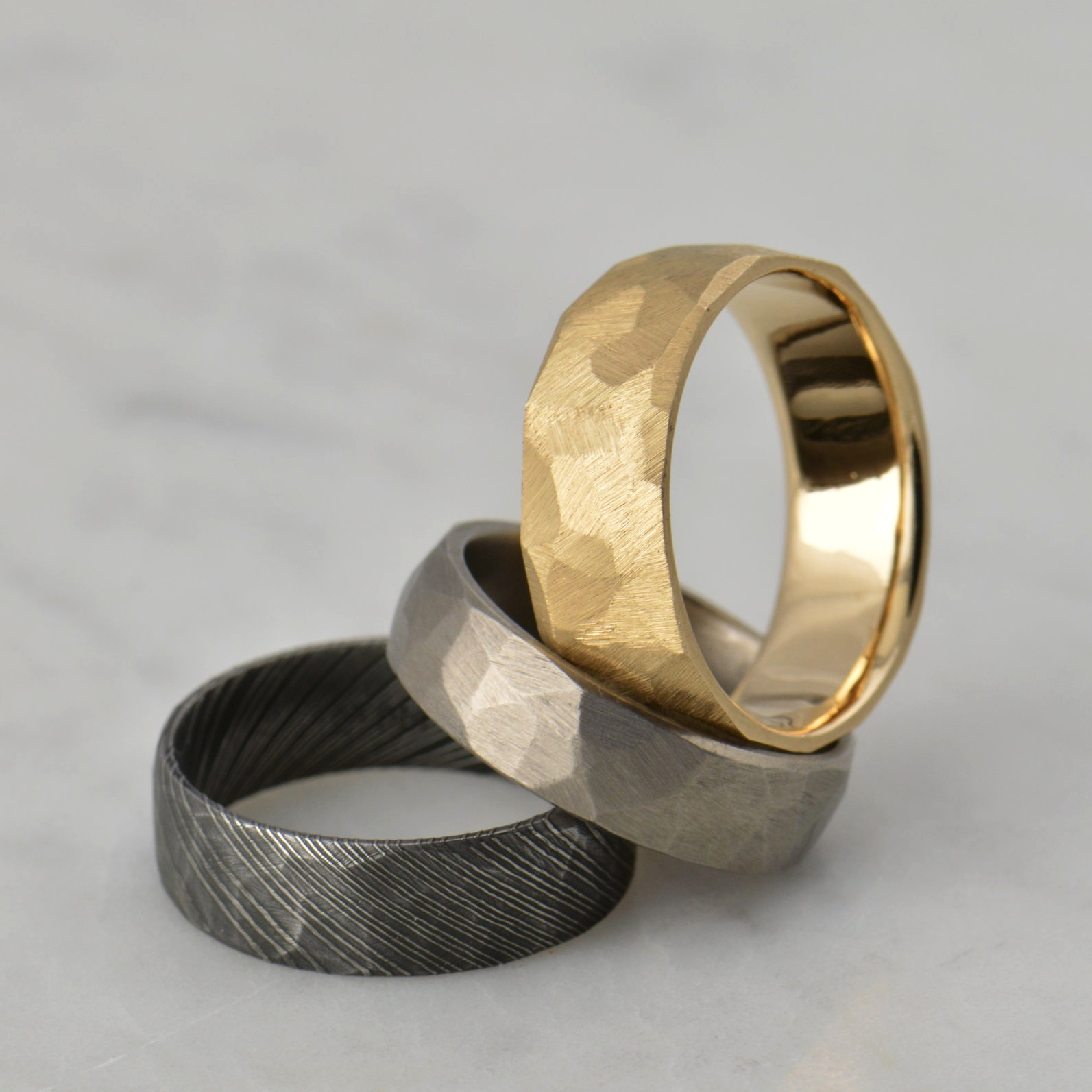 darvier-faceted-finish-damascus-titanium-14k-gold.JPG