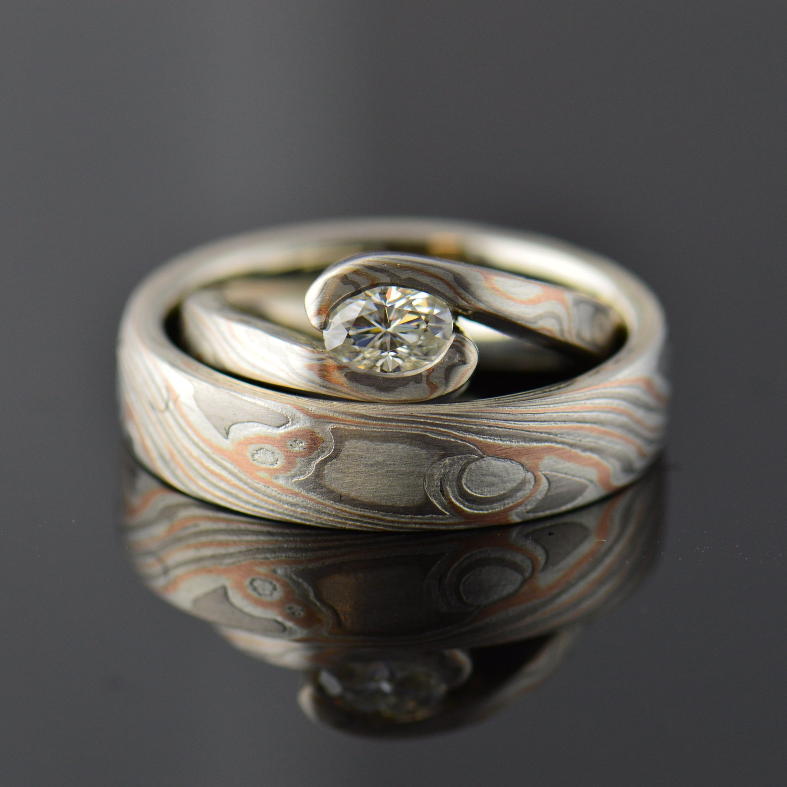darvier-mokume-hand-forged-set-oval-moissanite.JPG