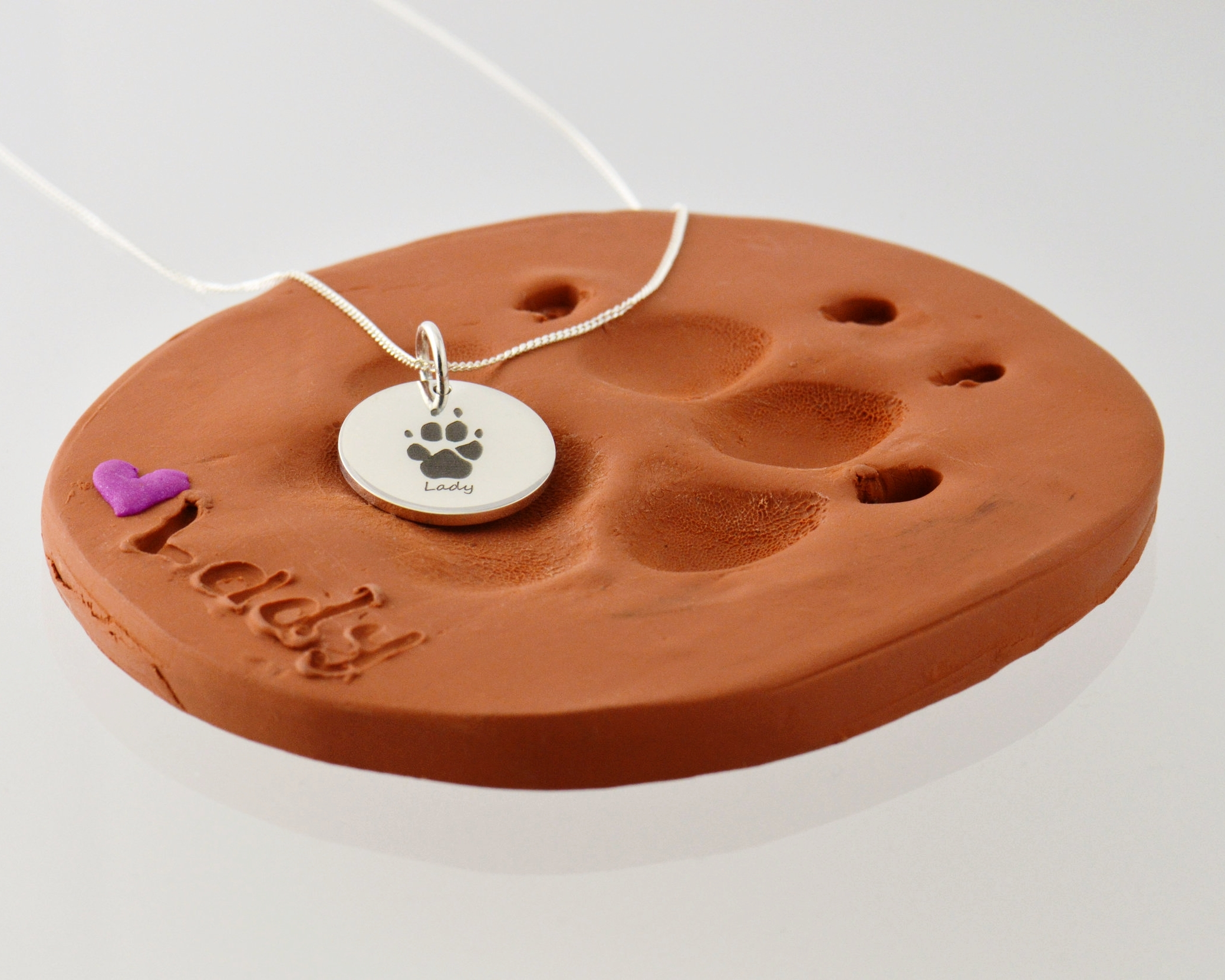 Remembrance in the form of paw print or nose print engraved pendants. We make too many of these, but always will.