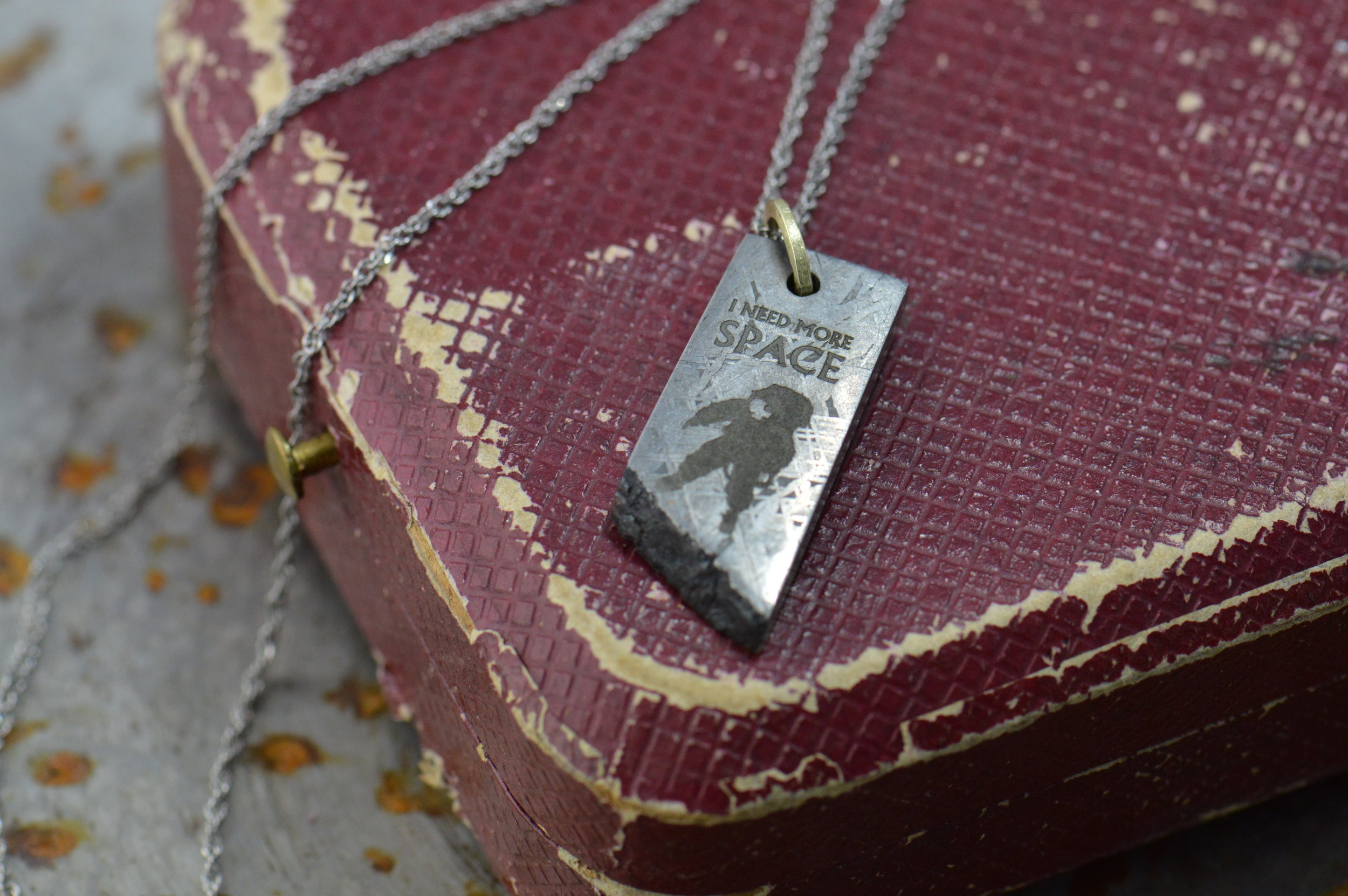 It's true on so many levels. Meteorite pendant with an honest Astronaut.