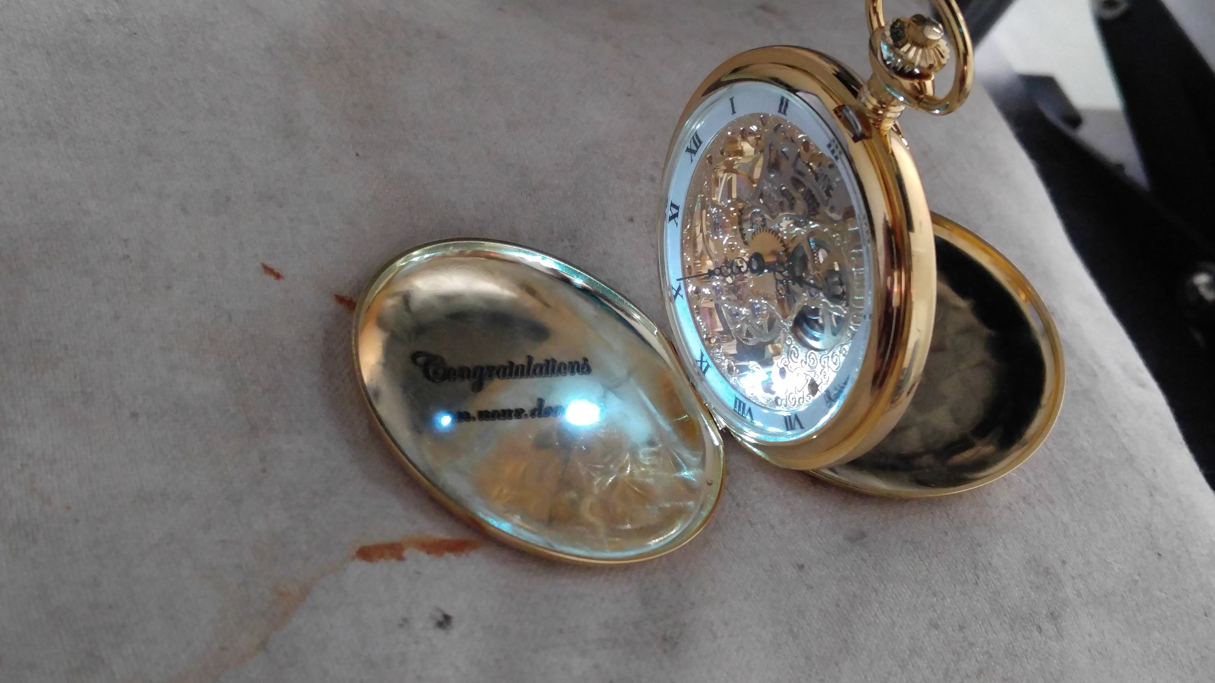 Pocket watch engraving in action.