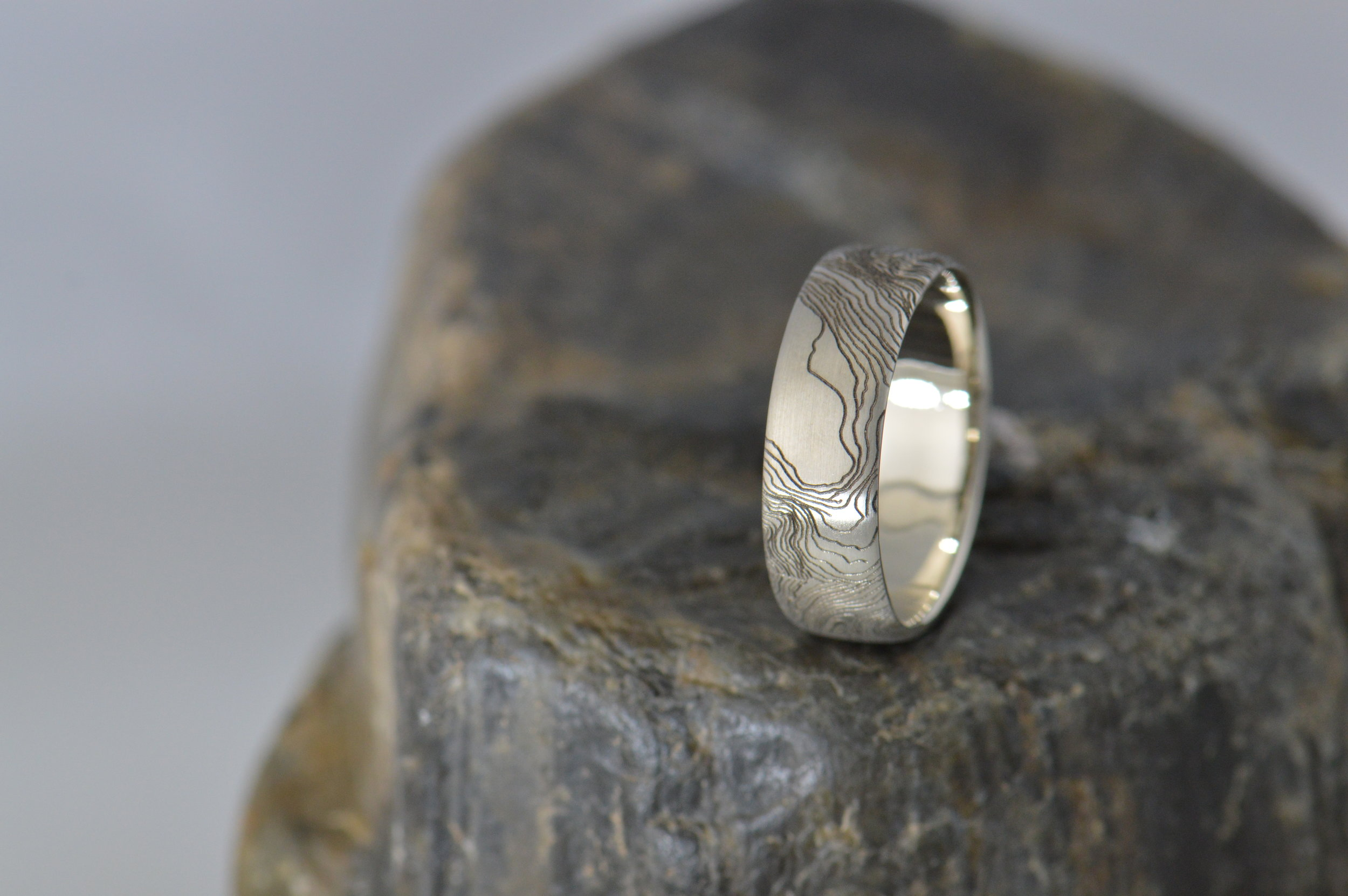 Topographic map on a wedding band.