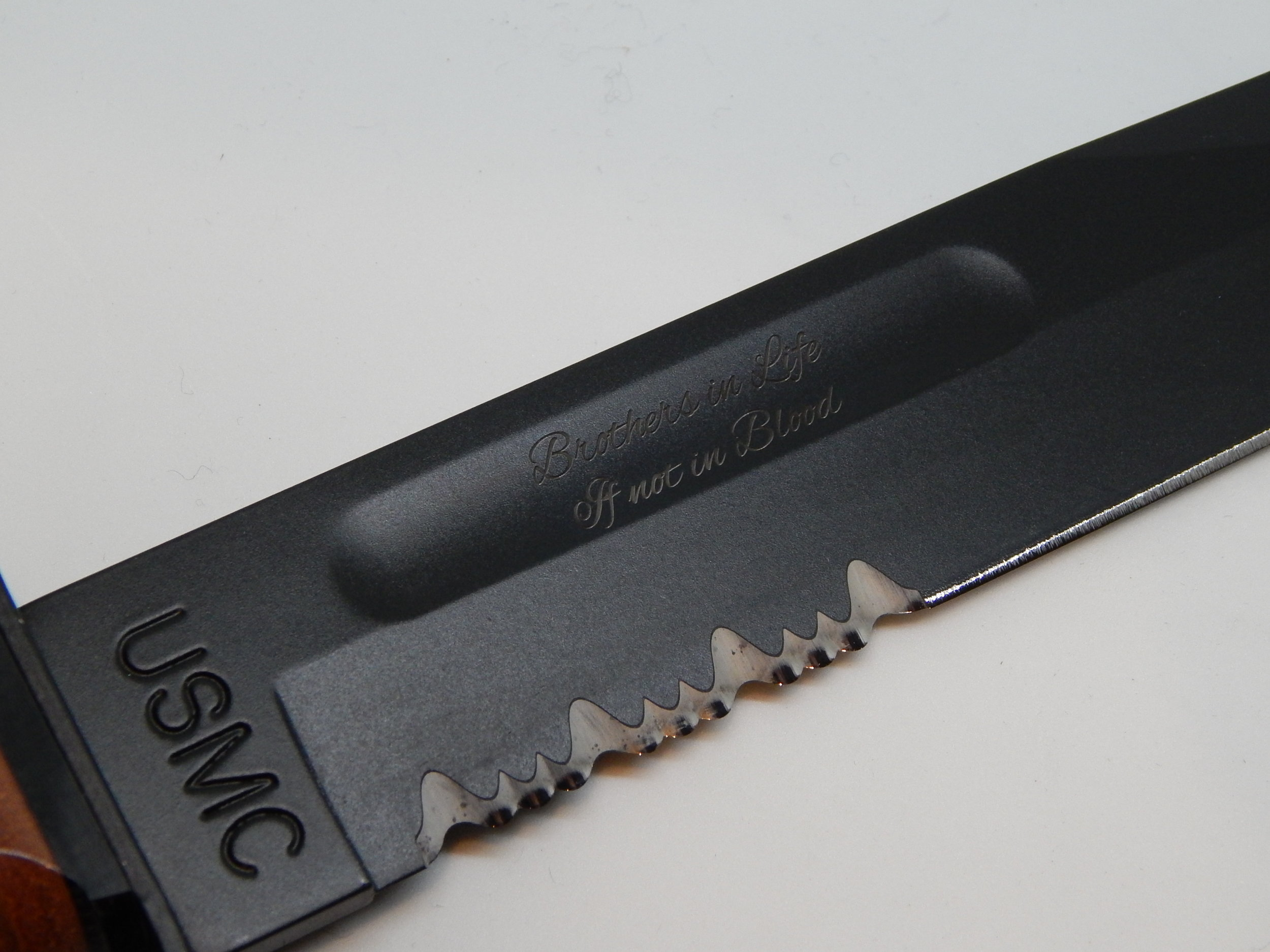 Engraving a powder coated knife.