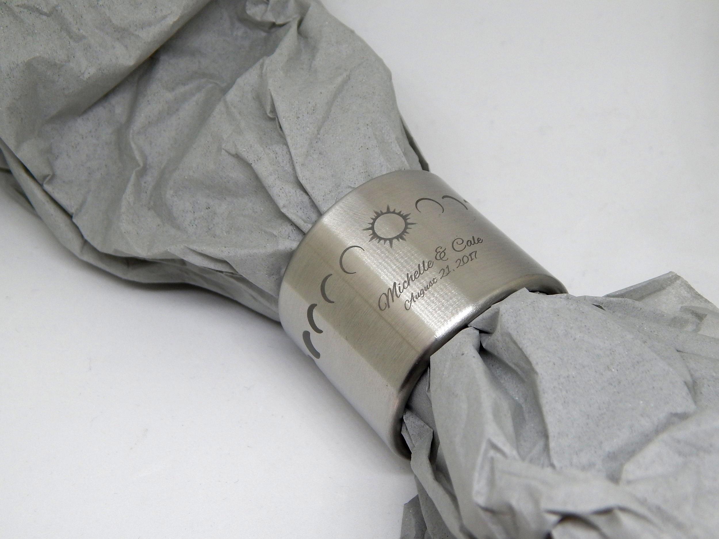 Celebratory napkin ring set engraved with their wedding date.
