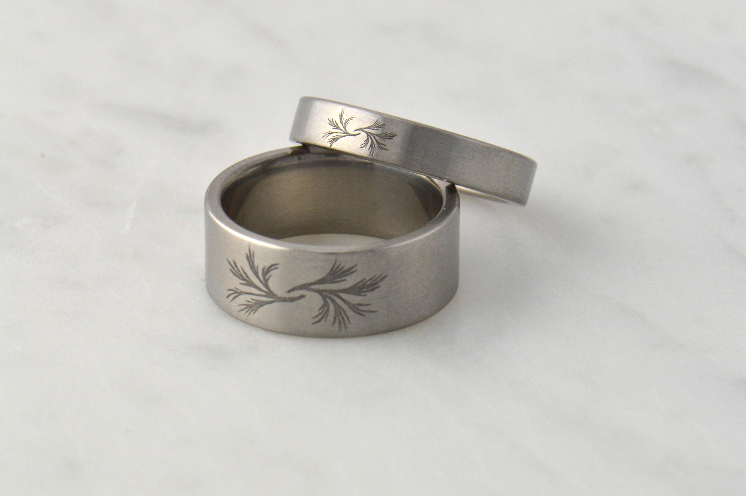 Sage engraved onto a titanium wedding set