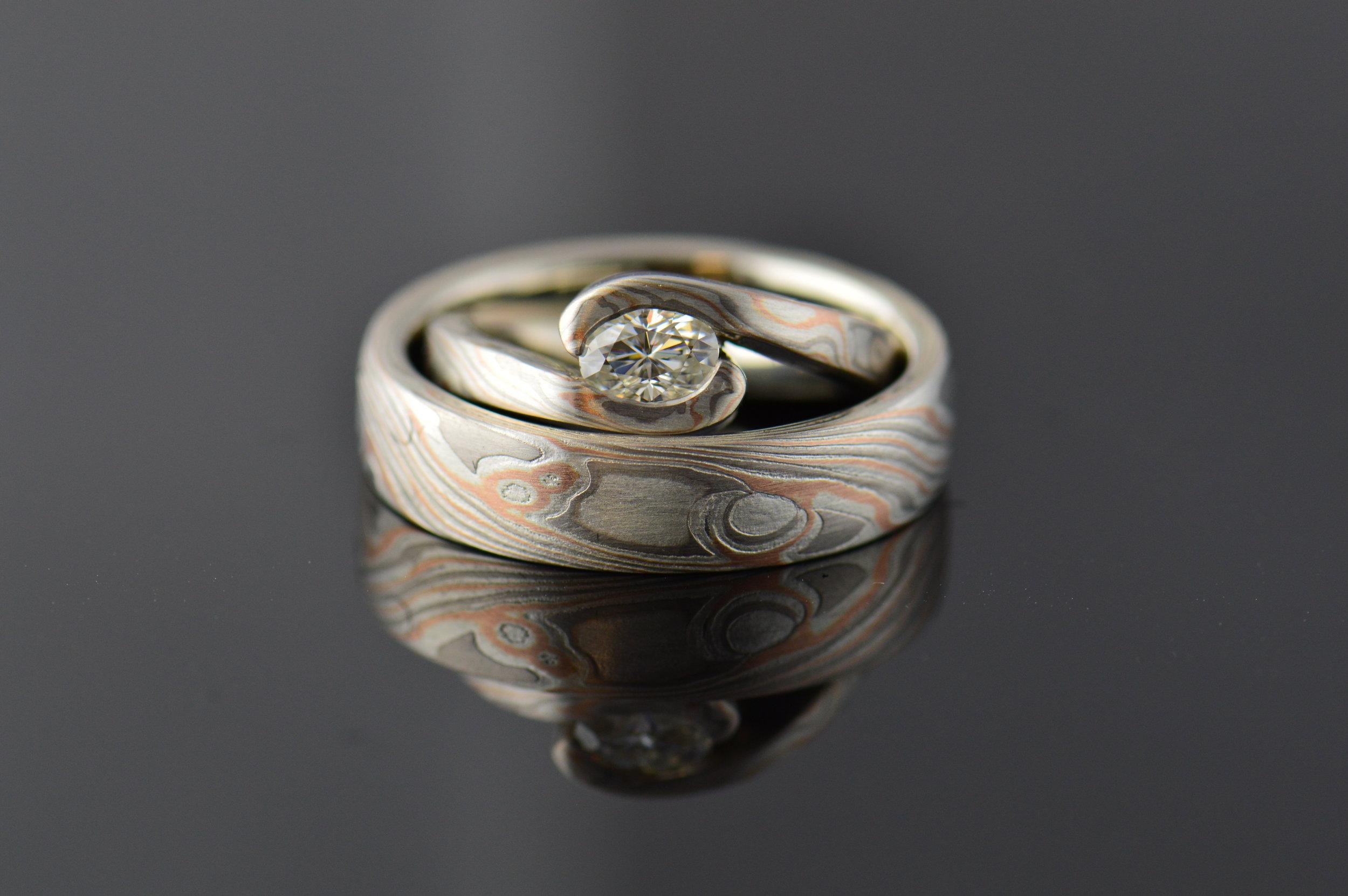 darvier-hand-forged-oval-diamond-wedding-set.JPG