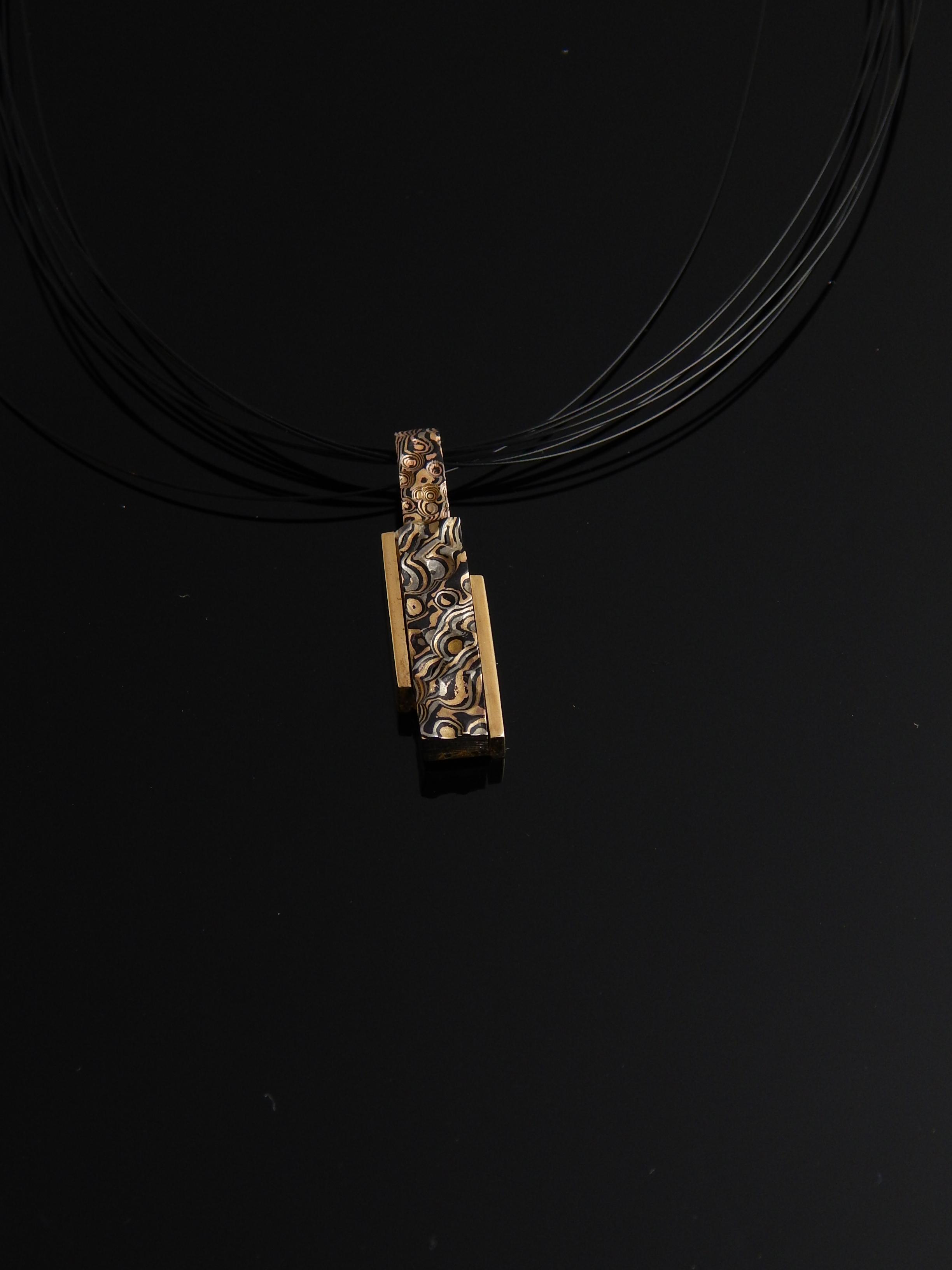 darvier-lunar-mokume-18k-tri-gold-shakudo-pendant.JPG