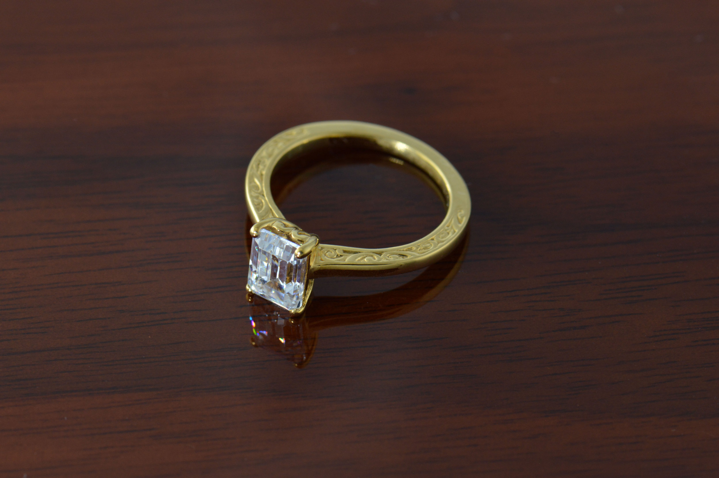 darvier-emerald-cut-diamond-18k-carved-engagement-ring.JPG