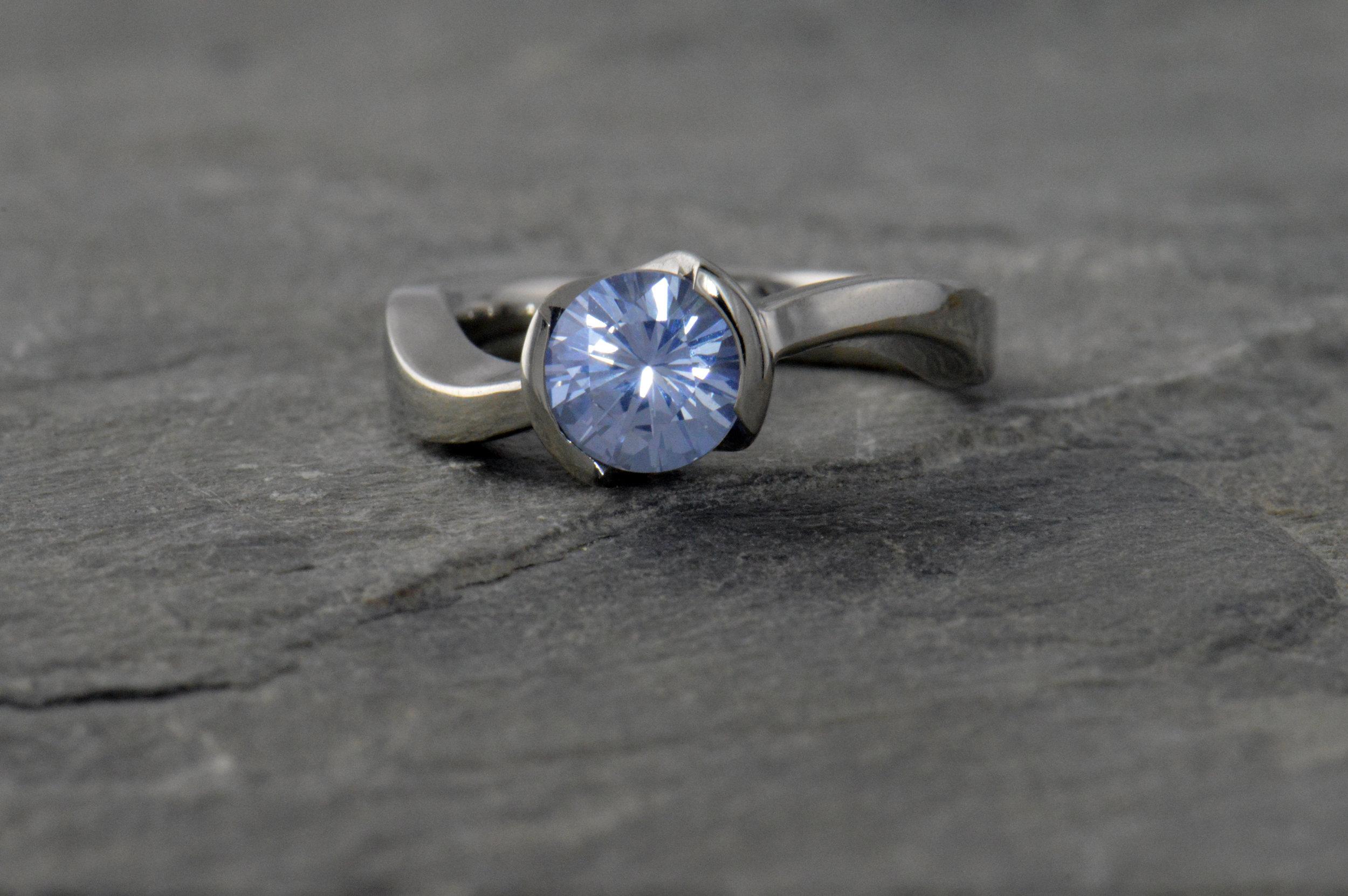 darvier-montana-sapphire-bezel-set-twist-engagement-ring.JPG