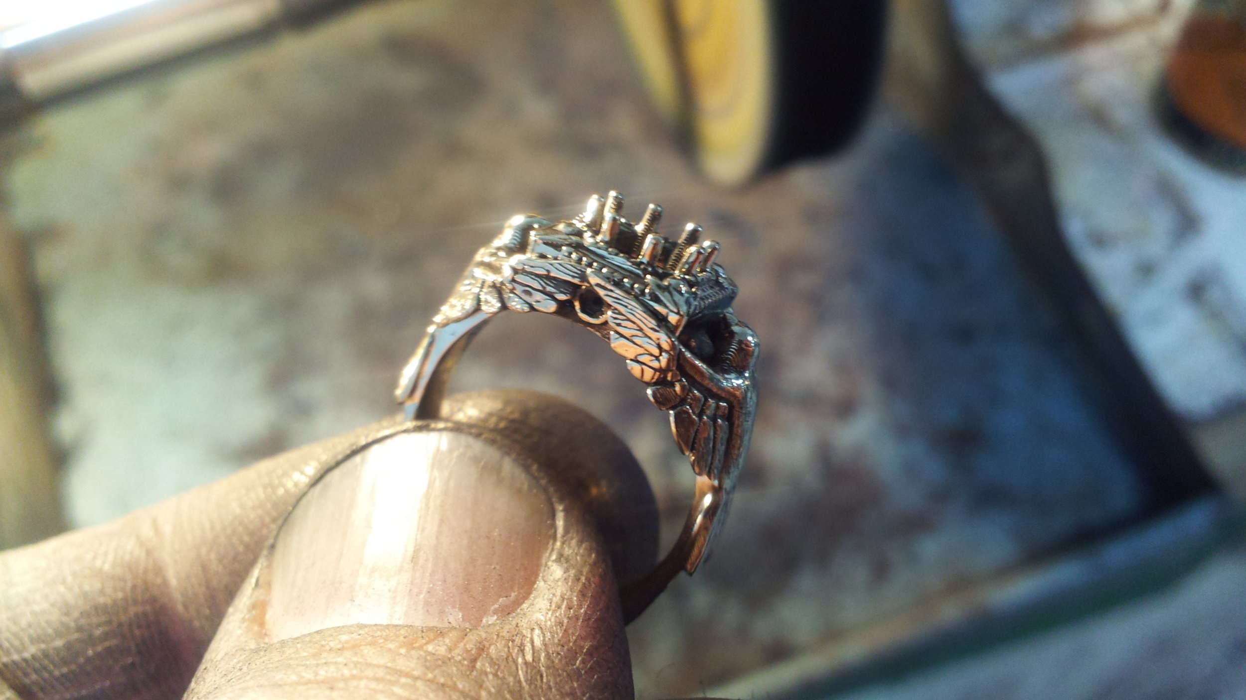 One of the first rings we 3D printed. It was a new technology in those days (waaay back in 2013). You can see the rudimentary build lines in the piece that we kept to emulate the feathers and organic style of this ring that was eventually set with a yellow sapphire. Resolution today rivals that of machining.