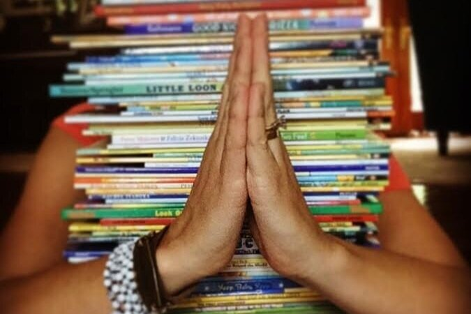prayer-pose-with-books.jpg