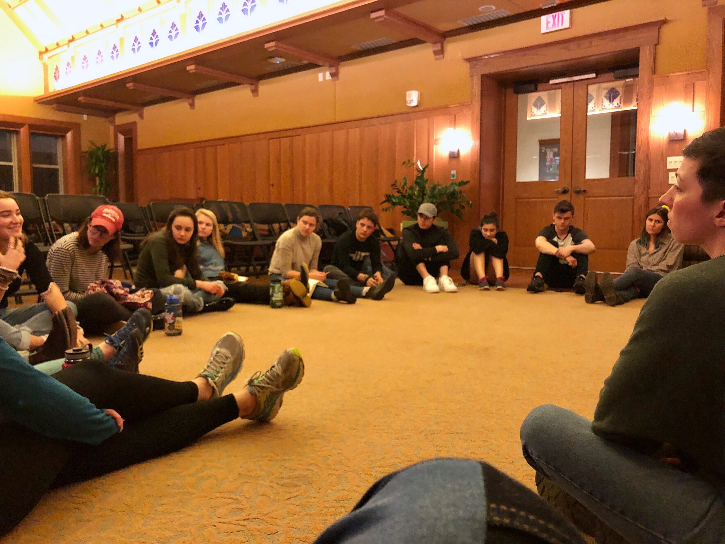 Students and panelists discussing Points of Intervention during the last event of the WashU PLAN Tour.