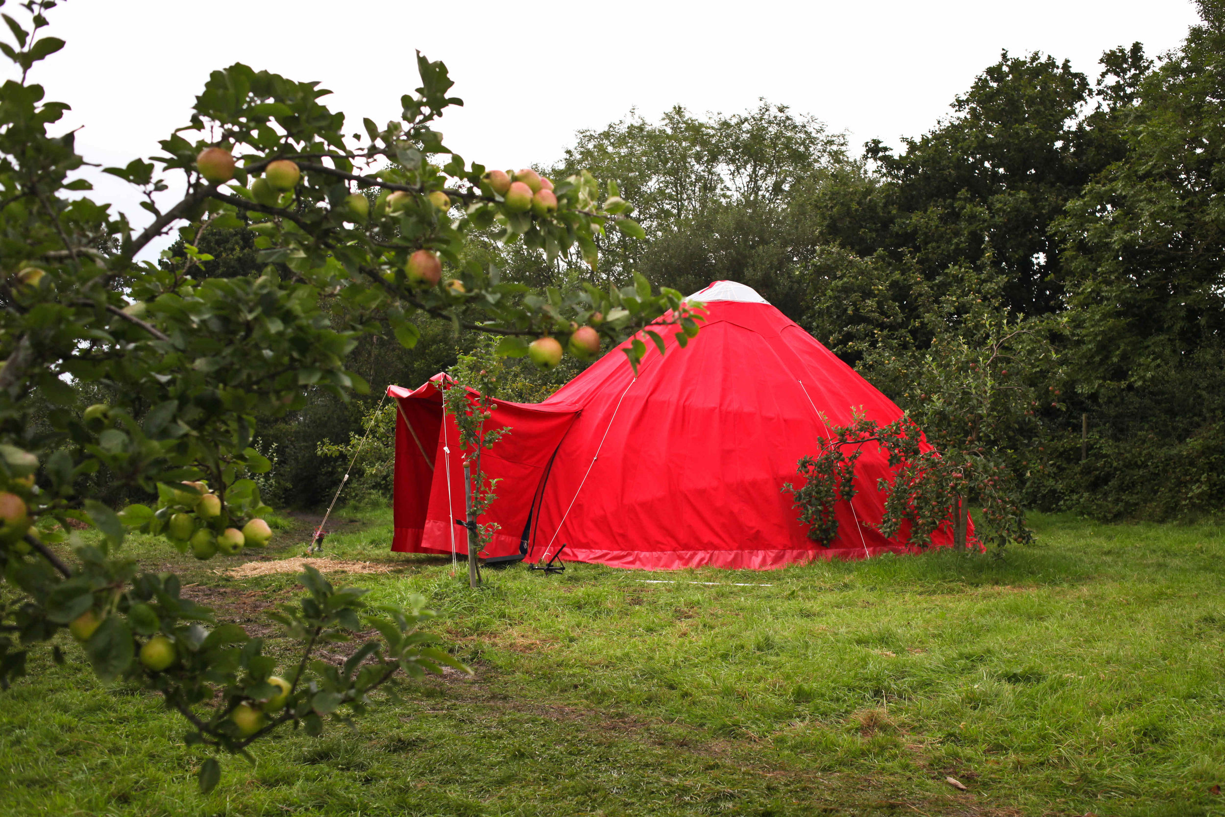 "THE RED ALACHIGH   The Red Alachigh was created in 2012 as a space for sacred sanctuary, ceremony, celebration, myth, music, crafts, arts and the exploration of women's mysteries.  The inspiration for the tent came from a storytelling at the Wood Sisters Mystery School based on Anita Diamant's novel ""The Red Tent"".  The alachigh is a northern Iranian nomadic tent and this one was built by about 50 women with support from all quarters to raise the money for the canvas and other materials.  The tent has toured to many festivals offering meditation, quiet space, storytelling, crafts, music, dance, poetry and more. It is held by a council of women who are delighted to bring it to the first Oxford Storytelling Festival."