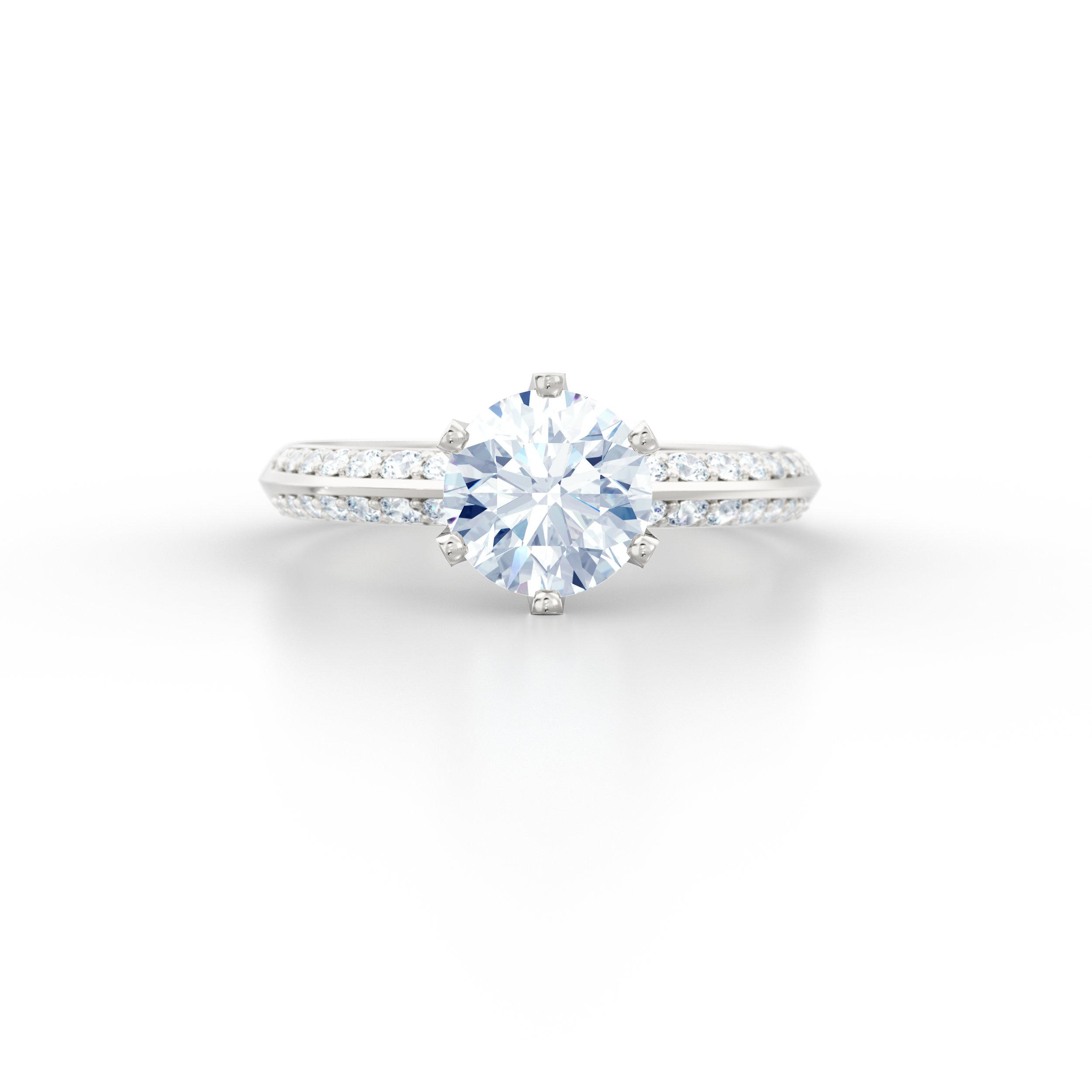 Brilliant cut knife edge diamond shoulder engagement ring