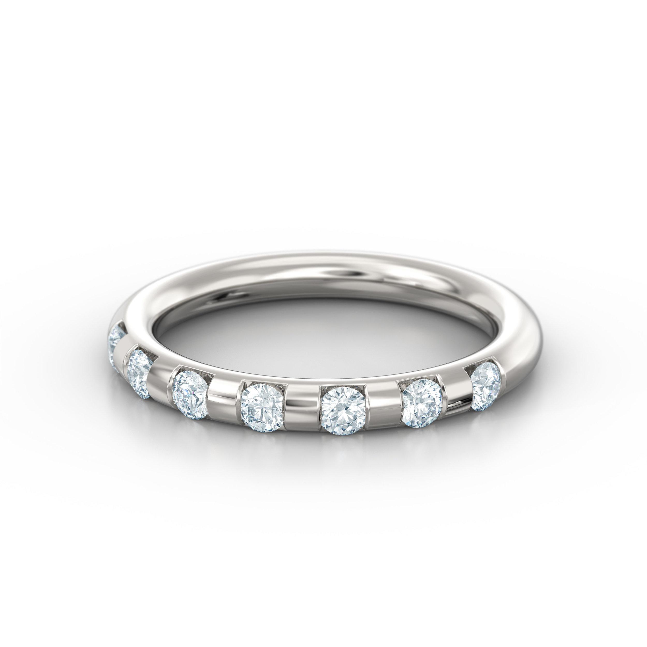 Brilliant cut off-set diamond eternity ring
