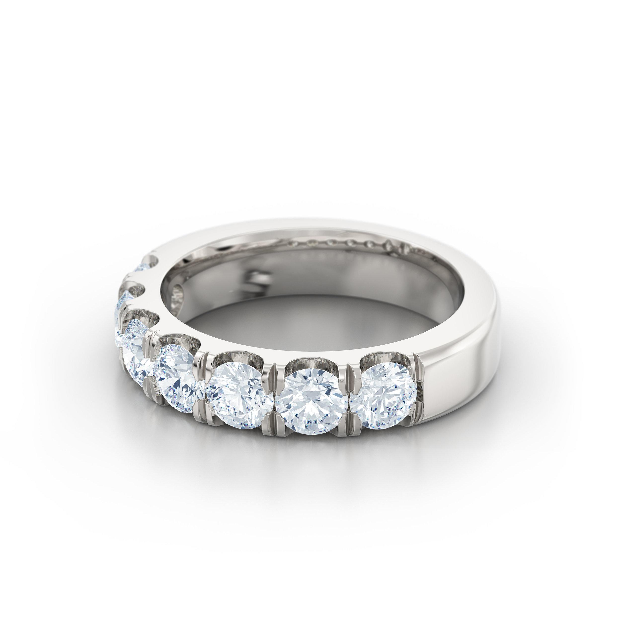 Brilliant cut split claw eternity ring