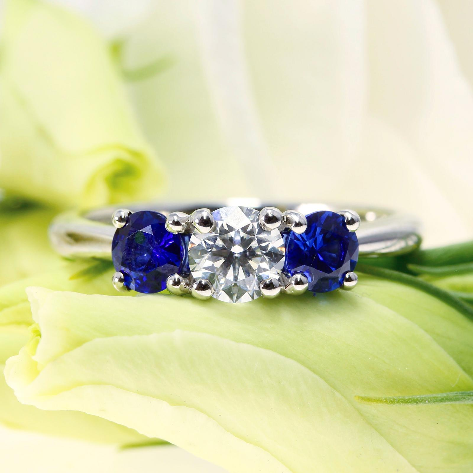 A Bespoke Trilogy Brilliant Cut Diamond & Sapphire Engagement Ring handcrafted in Hatton Garden, London.