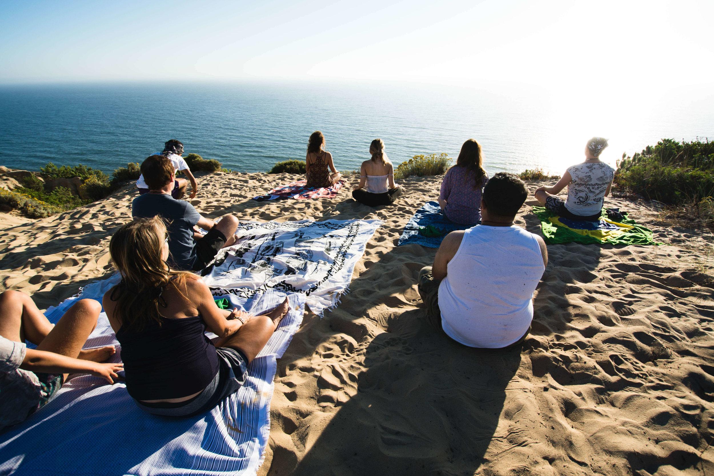 group-meditation-on-the-beach-breathe-portugal.jpg
