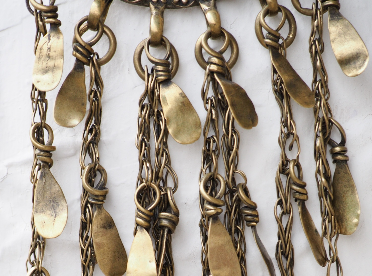 Fringed brass earring from Harar