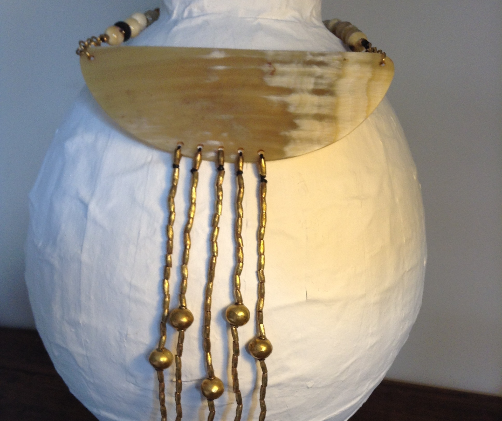 A choker with horn and brass elements from Ethiopia, inspired by Maasai beaded collarS