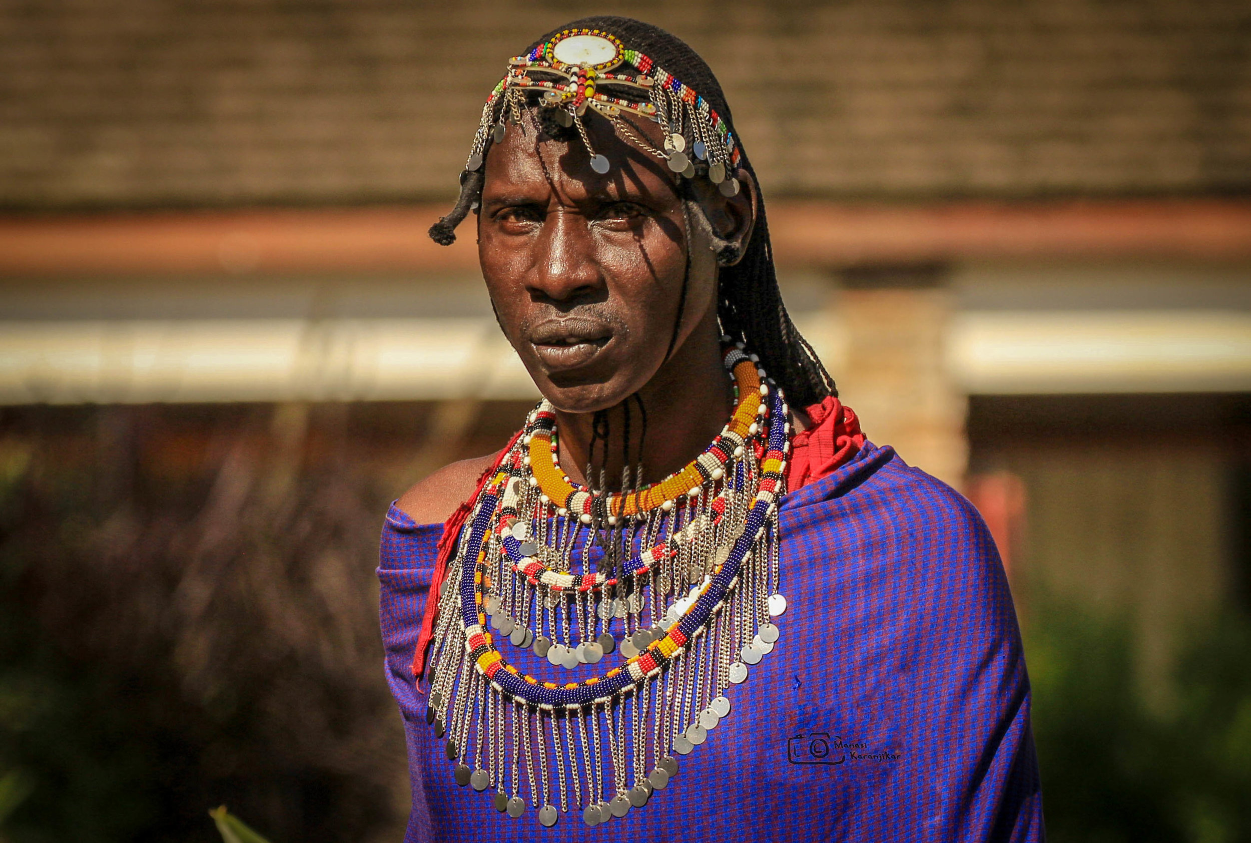 Masai man wearing a traditional FRINGED collar