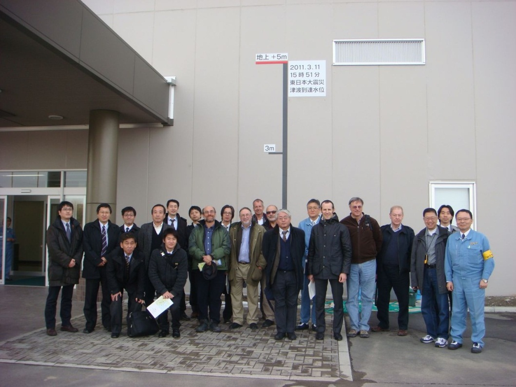 Figure 8 - Tour Group at Sendai Thermal Power Plant next to tsunami height measure